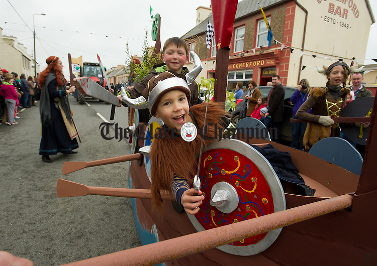 Aaron Torok and Cuan barrow heading into battle at the St Patrick's Day Parade in Doonbeg. Photograph by John Kelly.