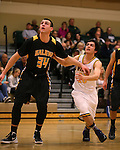Galena's Zack Lessinger and Manogue's James Sandoval watch for a rebound at Manogue High School in Reno, Nev., on Tuesday, Feb. 11, 2014. Manogue won 66-59.<br /> Photo by Cathleen Allison