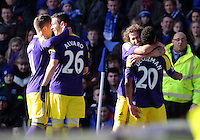 Pictured: Jonathan de Guzman of Swansea (R) with team mates Pablo Hernandez, Alvaro Vazquez and Jose Canas celebrating his equaliser making the score 1-1. Sunday 16 February 2014<br /> Re: FA Cup, Everton v Swansea City FC at Goodison Park, Liverpool, UK.