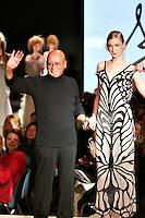 Roma 26/1/2004 <br /> Alta Moda Roma - Haute Couture - Fashion<br /> Dress collection of stylist Fausto Sarli<br /> in this picture the stylist Fausto Sarli with a model<br /> Foto Andrea Staccioli Insidefoto