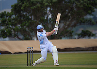 Iain McPeake hits a six during the Pearce Cup Wellington men's cricket match between Johnsonville and Hutt Districts at Alex Moore Park in Johnsonville, New Zealand on Saturday, 6 March 2021. Photo: Dave Lintott / lintottphoto.co.nz