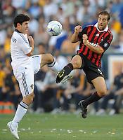 Los Angeles Galaxy's Alecko Eskandarian and AC Milan Mathieu Flamini both miss the ball at the Home Depot Center. Los Angeles Galaxy tied AC Milan 2-2 Sunday, July 19. 2009, in Carson, California.