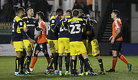 Phil Edwards of Oxford United (hidden) celebrates scoring their first goal with team mates during the The Checkatrade Trophy Semi Final match between Luton Town and Oxford United at Kenilworth Road, Luton, England on 1 March 2017. Photo by Stewart  Wright  / PRiME Media Images.