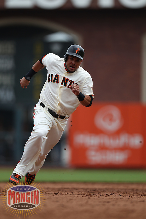 SAN FRANCISCO, CA - JULY 1:  Melky Cabrera #53 of the San Francisco Giants runs the bases against the Cincinnati Reds during the game at AT&T Park on Sunday, July 1, 2012 in San Francisco, California. Photo by Brad Mangin