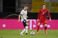 Joshua Kimmich (Deutschland Germany) gegen Andreas Olsen (Dänemark, Denmark) - Innsbruck 02.06.2021: Deutschland vs. Daenemark, Tivoli Stadion Innsbruck