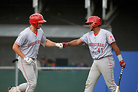 Greeneville Reds left fielder Brandt Stallings (25) is congratulated by Jose Tello (41) as he returns to the dugout after hitting a home run in the top of the second inning during the second game of a doubleheader against the Princeton Rays on July 25, 2018 at Hunnicutt Field in Princeton, West Virginia.  Greeneville defeated Princeton 8-7.  (Mike Janes/Four Seam Images)