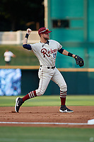 Frisco RoughRiders Charles Leblanc (12) throws to first base during a Texas League game against the Amarillo Sod Poodles on May 17, 2019 at Dr Pepper Ballpark in Frisco, Texas.  (Mike Augustin/Four Seam Images)