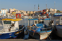 - Lampedusa island, the more southern part of the Italian territory, in front of the Tunisinian African coasts, fishing boats in the harbor ....- isola di Lampedusa, la parte del territorio italiano più meridionale, di fronte alle coste africane tunisine, pescherecci in porto
