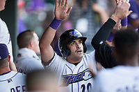 Aaron Schnurbusch (20) of the Winston-Salem Dash high fives his teammates after scoring a run against the Buies Creek Astros at BB&T Ballpark on April 13, 2017 in Winston-Salem, North Carolina.  The Dash defeated the Astros 7-1.  (Brian Westerholt/Four Seam Images)