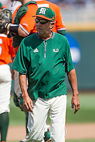 Miami Hurricanes head coach Jim Morris walks from the mound during of the NCAA College World Series against the UC Santa Barbara Gauchos in Game 5 on June 20, 2016 at TD Ameritrade Park in Omaha, Nebraska. UC Santa Barbara defeated Miami  5-3. (Andrew Woolley/Four Seam Images)
