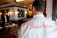 Thierry Paludetto, head chef (back to camera), speaks to his colleagues, Bouchon restaurant, Monaco, 23 March 2012