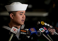 111227-N-DR144-613 HONG KONG (Dec. 27, 2011) Machinist's Mate 1st Class Ryan Lu, assigned to Reactor Department, speaks to members of the Hong Kong press in Cantonese during a media tour of Nimitz-class aircraft carrier USS Carl Vinson (CVN 70). The Carl Vinson Strike Group is currently anchored in Hong Kong Harbor for a port visit.  (U.S. Navy photo by Mass Communication Specialist 2nd Class James R. Evans/Released)