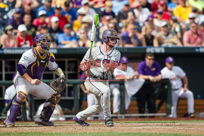 TCU Horned Frogs catcher Evan Skoug (9) follows through on his swing against the LSU Tigers in the NCAA College World Series on June 14, 2015 at TD Ameritrade Park in Omaha, Nebraska. TCU defeated LSU 10-3. (Andrew Woolley/Four Seam Images)