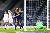 21st September 2021; Hampden Park, Glasgow, Scotland: FIFA Womens World Cup qualifying, Scotland versus Faroe Islands; Chloe Arthur of Scotland celebrates after she beats Oluva Allansdottir Joensen of Faroe Islands in the air to make it 3-0 in the 27th minute