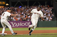 21 April 2009: San Francisco Giants' shortstop Edgar Renteria is congratulated by third base coach Tim Flannery as he runs the bases after his grand slam off San Diego Padres starting pitcher Jake Peavy in the fourth inning  during the San Francisco Giants' 8-3 win over the San Diego Padres at AT&T Park in San Francisco, CA.