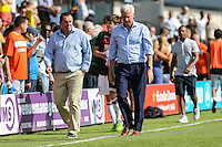 Martin Allen (Manager) of Barnet (left) and Alan Pardew (Manager) of Crystal Palace leave the pitch after the Friendly match between Barnet and Crystal Palace at The Hive, London, England on 11 July 2015. Photo by David Horn.