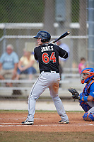 Miami Marlins catcher Alex Jones (64) at bat during a minor league Spring Training game against the New York Mets on March 26, 2017 at the Roger Dean Stadium Complex in Jupiter, Florida.  (Mike Janes/Four Seam Images)