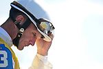 18 October 2009: Jockey Calvin Borel prepares to pull his goggles on before the start of the second race aboard Beau's Valentine. The pair went on to win the race handily.