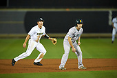 Siena Saints Jordan Folgers (12) leads off in front of shortstop Brennan Bozeman (21) during a game against the UCF Knights on February 17, 2017 at UCF Baseball Complex in Orlando, Florida.  UCF defeated Siena 17-6.  (Mike Janes/Four Seam Images)