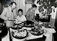 1979 FILE PHOTO - ARCHIVES -<br /> <br /> A welcoming feast: Phat Yen Hua; 13; had his plate heaped high by Peter Pattera; manager of Holiday Inn West yesterday; at a luncheon in honor of the Hua refugee family. The 12-member family is being sponsored by 50 families from St. James-Islington United Church. There are too many Huas for the apartment provided for the family so the Holiday Inn is giving free accommodation to a son and his wife and child until second apartment can be found. Family arrived last week.<br /> <br /> <br /> Bezant, Graham<br /> Picture, 1979<br /> <br /> 1979,<br /> <br /> PHOTO : Graham Bezant - Toronto Star Archives - AQP
