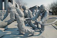 """- 20 years from the nuclear incident of Chernobyl, in front of the barracks of Chernobyl's firemen has been erected the monument to the """"Liquidators"""", the civil and military personnel (more than 300.000 persons) that  worked in proibitive conditions and with  insufficient protections in order to put in safety the exploded reactor, very many of them have died subsequently for the effects of radiations..- 20 anni dall'incidente nucleare di Chernobyl, davanti alla caserma dei pompieri di Chernobyl è stato eretto il monumento ai """"Liquidatori"""", il personale civile e militare (più di 300.000 persone) che operò in condizioni proibitive e con scarsissime protezioni per mettere in sicurezza il reattore esploso, moltissimi di loro sono morti successivamente per gli effetti delle radiazioni"""