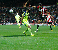 Yoann Barbet of Brentford clears the danger during the Sky Bet Championship match between Brentford and Derby County at Griffin Park, London, England on 26 September 2017. Photo by Carlton Myrie / PRiME Media Images.