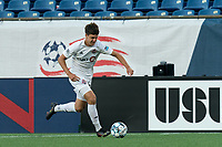 FOXBOROUGH, MA - JULY 9: Themi Antonoglou #81 of Toronto FC II brings the ball forward during a game between Toronto FC II and New England Revolution II at Gillette Stadium on July 9, 2021 in Foxborough, Massachusetts.