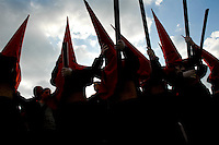 The Holy Week penitents carry large processional candles during the Easter celebration in Malaga, Spain, 5 April 2007.