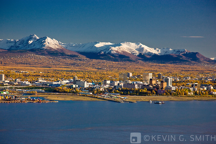 Aerial photo of the Anchorage Skyline, looking south over Knik Arm with the Chugach Mountains in the background, Fall, Anchorage, Southcentral Alaska, USA.