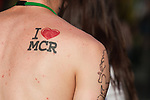 """© Joel Goodman - 07973 332324 - all rights reserved . 23/06/2010 . Manchester , UK . A man with an """" I LOVE MCR """" I love Manchester tattoo in Piccadilly Gardens . Photo credit : Joel Goodman"""