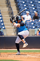 Tampa Tarpons third baseman Andres Chaparro (24) bats during a game against the Lakeland Flying Tigers on July 18, 2021 at George M. Steinbrenner Field in Tampa, Florida.  (Mike Janes/Four Seam Images)