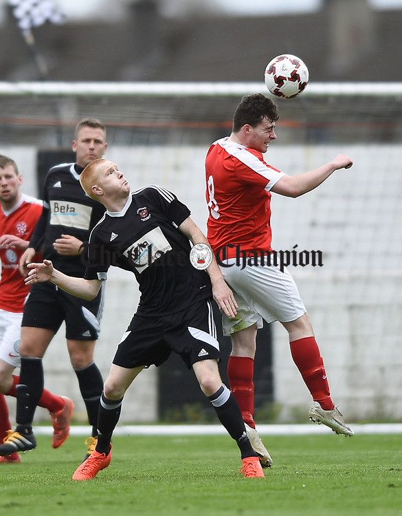 Ian Collins of Newmarket Celtic in action against Adrian Power of Janesboro during their Munster Junior Cup semi-final at Limerick. Photograph by John Kelly.