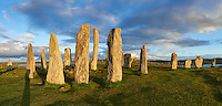 Panorama of Calanais Standing Stones  central stone circle erected between 2900-2600BC measuring 11 metres wide. At the centre of the ring stands a huge monolith stone 4.8 metres high weighing about 7 tonnes, which is perfectly orientated so that its widest sides face due north south. Calanais Neolithic Standing Stone (Tursachan Chalanais) , Isle of Lewis, Outer Hebrides, Scotland.