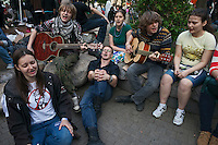 Moscow, Russia, 15/05/2012..Protesters sing in Chistiye Prudy, or Clean Ponds, as a Moscow court ordered the eviction of some 200 opposition activists who have set up camp in the city centre park.