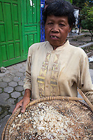 Borobudur, Java, Indonesia.  Woman Carrying Left-over Rice from an Earlier Meal, to be Re-used in Next Meal.