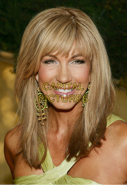 LEEZA GIBBONS.11th Annual DesignCare event benefiting the HollyRod Foundation held at a Private Residence, Beverly Hills, CA, USA..July 25th, 2009.headshot portrait earrings green .CAP/ADM/TL.©Tony Lowe/AdMedia/Capital Pictures.