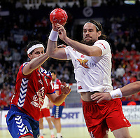Thomas M. Mogensen (R) of Denmark in action during men`s EHF EURO 2012 handball championship final game between Serbia and Denmark in Belgrade, Serbia, Sunday, January 29, 2011.  (photo: Pedja Milosavljevic / thepedja@gmail.com / +381641260959)