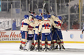 Rochester Amerks celebrate a shootout victory during The Frozen Frontier outdoor AHL game against the Lake Erie Monsters at Frontier Field on December 13, 2013 in Rochester, New York.  (Copyright Mike Janes Photography)