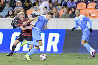 Houston, TX - Friday December 9, 2016: Nils Bruening (14) of the North Carolina Tar Heels and Derek Waldeck (29) of the Stanford Cardinal battle for control of the ball at the NCAA Men's Soccer Semifinals at BBVA Compass Stadium in Houston Texas.