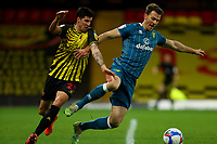 26th December 2020; Vicarage Road, Watford, Hertfordshire, England; English Football League Championship Football, Watford versus Norwich City; Christoph Zimmermann of Norwich City <br /> under pressure from Stipe Perica of Watford