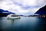The Norwegian Sun cruises into Juneau, Alaska for a stopover during an Alaskan cruise. The Norwegian Cruise Lines ship was built in 2001 and can carry up to 2400 passengers.