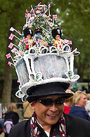 Tourist with his royal hat looks for Princess Kate and Prince William  as the Royal party come down the mall in London. .Picture: Maurice McDonald/Universal News And Sport (Europe).29 April 2011..