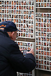 Harold Siegfried, of Carson City, takes a picture of his nephew on the Wall of the Dead at the opening ceremony of the Always Lost: A Meditation on War exhibit at the Legislative Building in Carson City, Nev., on Monday, April 6, 2015. His nephew Army Pvt. Theodore Rushing died Nov. 11, 2011 in Afghanistan. <br />