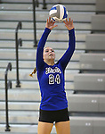 Marymount's Emileigh Rettig tips during a college volleyball match at Washington & Lee University Lexington, Vir., on Saturday, Oct. 5, 2013.<br /> Photo by Cathleen Allison