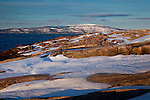 Winter alpenglow on Cadillac Mountain and Schoodic Point in Acadia National Park, Downeast, ME, USA