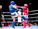 Purevjav Davaa (Red) of Mongolia fights against Tsang Ching Yee (Blue) of Hong Kong in the female muay 54KG division weight bout during the East Asian Muaythai Championships 2017 at the Queen Elizabeth Stadium on 13 August 2017, in Hong Kong, China. Photo by Yu Chun Christopher Wong / Power Sport Images