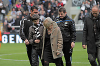 Pictured: One of Gary Speed's sons comforts Alan Shearer's wife (CHECK) after spectators applauded in tribute to his late dad. <br /> Re: Newcastle United FC v Swansea City FC at St James' Park, Newcastle Upon Tyne.