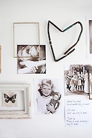 Among the photographs on the wall of the living room is a heart made from the remains of an old pipe