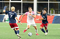 FOXBOROUGH, MA - SEPTEMBER 04: Connor Presley #7 of New England Revolution II and Ryan Spaulding #34 of New England Revolution II move in to tackle Wojciech Wojcik #9 Forward Madison FC during a game between Forward Madison FC and New England Revolution II at Gillette Stadium on September 04, 2020 in Foxborough, Massachusetts.