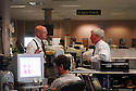 The Times-Picayune managing editor Dan Shea speaks to editor Jim Amoss, New Orleans, Wednesday, April 5, 2006..(Cheryl Gerber for New York Times)..